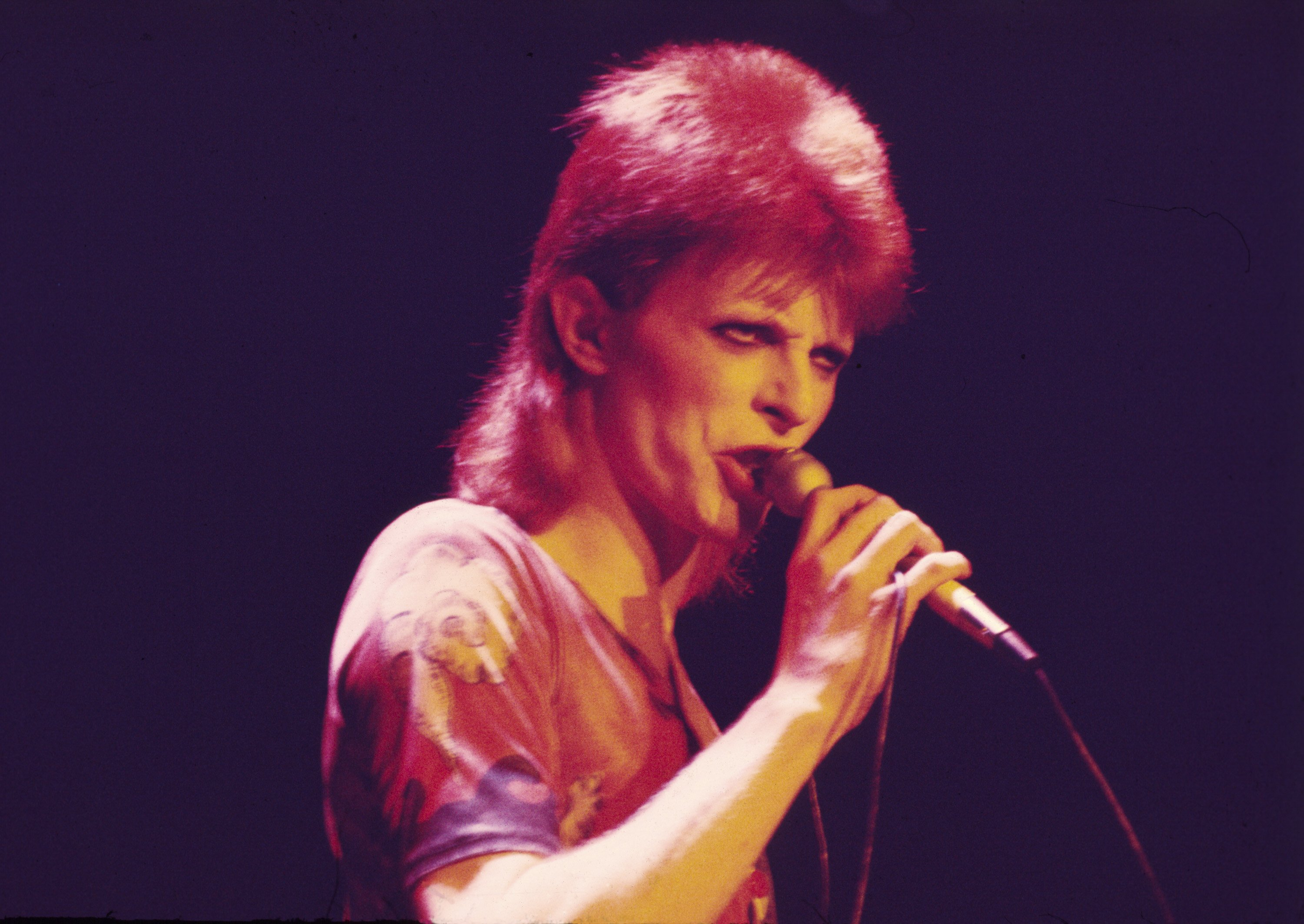 David Bowie performs as Ziggy Stardust, 1973  (Photo by Chris Walter/WireImage)